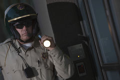 Traffic Cop Investigating With Flashlight At Night Stock Photo