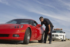 Traffic Cop Stopping Red Sports Car Stock Images