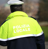 Traffic cop with uniform with the words local police in italian Stock Image