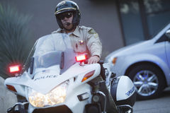 Traffic Cop Wearing Helmet While Riding Motorbike Royalty Free Stock Image