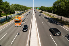 Traffic on Copenhagen highway. COPENHAGEN, DENMARK - JULY 9, 2014: Quiet summer traffic on the main highway Lyngbyvejen leading into the Danish capital of Stock Photography