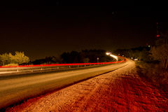 Traffic in a country road by night Stock Image