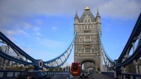 Traffic crosses Tower Bridge in London stock video