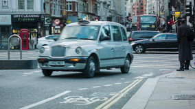 Traffic at crossroad in London. People crossing the Street at a crossroad in London stock footage