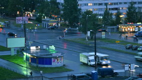 Traffic on a crossroad in St. Petersburg, Russia. St. Petersburg, Russia - August 26, 2015: Time lapse of traffic in evening on the crossroad of Prosveshchenia stock footage