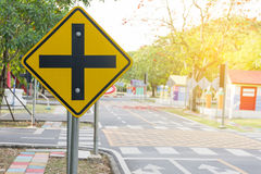 Traffic crossroads. A road sign warns of an intersection ahead. Closeup Royalty Free Stock Photo