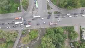 Traffic on crossroads in Russia. Flying over the crossroad in the city of Perm, shows transport traffic (view camera down stock footage