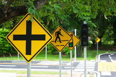 Traffic crossroads sign & symbols on the load Royalty Free Stock Photo