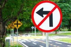 Traffic crossroads sign & symbols on the load Stock Image