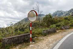 The traffic curve mirror. Mountain road, Vietnam royalty free stock images