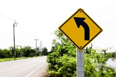 The traffic curve of right arrow in yellow sign. Background royalty free stock images