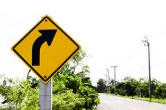 The traffic curve of right arrow in yellow sign. Background royalty free stock photo