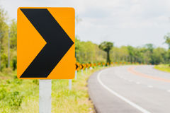Traffic curve. Traffic sign indicating a curve Stock Photography