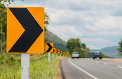 Traffic curve. Traffic sign indicating a curve Stock Image