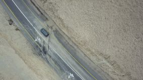 Traffic on the desert road to dead sea. Aerial top view shot stock video footage