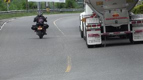 Dangerous Driving Motorcycle And Oil Truck. Traffic in a developing nation royalty free stock photos