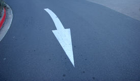 Traffic directions. Arrow on the pavement in Australia Royalty Free Stock Photos