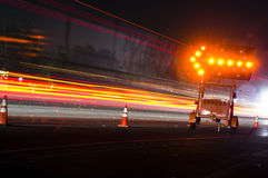 Traffic Directions and Light Trails Stock Images