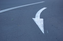 Traffic directions turn. Arrow on the pavement in Australia Stock Photography