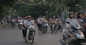 Traffic with domination of motorbikes. Hanoi, Vietnam. HANOI, VIETNAM - OCTOBER 27, 2015: City transportation. Busy traffic on the roads with motorbikes stock video footage