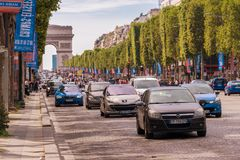 Traffic down the Champs Elysees Avenue and the Arc de Triomphe. Paris, France - 23 June 2018: Traffic down the Champs Elysees Avenue and the Arc de Triomphe Stock Images
