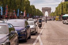 Traffic down the Champs Elysees Avenue and the Arc de Triomphe. Paris, France - 23 June 2018: Traffic down the Champs Elysees Avenue and the Arc de Triomphe Stock Image
