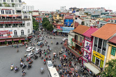 Traffic in Downtown Hanoi, Vietnam. Scooters and Cars meet at uncontrolled intersection in old quarter of Hanoi, Vietnam Stock Image