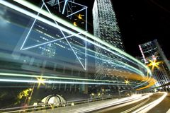 Traffic through downtown in Hong Kong. Light trails in Hong Kong Royalty Free Stock Images