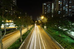 Traffic through downtown in Hong Kong. Light trails in Hong Kong Royalty Free Stock Photography