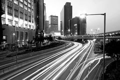 Traffic through downtown in Hong Kong at night. It is in black and white toned Stock Photography