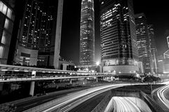 Traffic through downtown in Hong Kong at night. It is in black and white toned Royalty Free Stock Photos