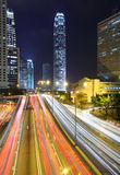 Traffic through downtown at night Stock Image