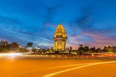 Traffic drives around the Independence Monument in downtown Phnom Penh, Cambodia Royalty Free Stock Photography