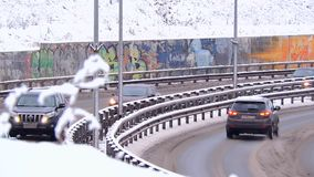 Traffic driving along city road during intense snow storm. 1 stock footage