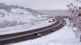 Traffic driving along freeway during heavy snow storm. stock footage