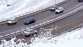 Traffic driving along freeway during heavy snow storm. Traffic driving along city road during intense snow storm 1 stock footage