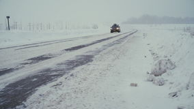 Traffic driving along freeway during intense snow storm. stock footage
