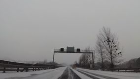 Traffic driving along motorway in Germany. During heavy snow storm. Recorded from dash camera stock video