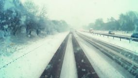 Traffic driving along motorway A1M in Great Britain. During heavy snow storm. Recorded from dash camera stock video