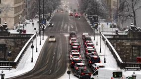 Traffic is driving through the snow during the snow storm - Aerial Time lapse. Traffic is driving through the snow during the snow storm n Munich, Germany stock video footage