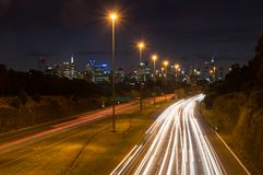 Traffic on the Eastern Freeway in Melbourne, Australia. Traffic on the Eastern Freeway at dusk, passing through Yarra Bend Park, as seen from the Yarra Bend Road Stock Images