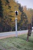 Traffic enforcement camera speed control radar camera. At countryside road highway Latvia Royalty Free Stock Photo