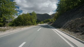 Traffic on an even straight road to the mountains in the summer. stock video footage