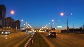 Traffic of the evening city. Evening city at high mode. Highway at rush hour. Blurring background of night city. Night city in the lights stock footage