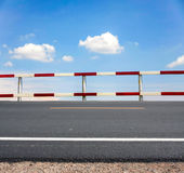 Traffic fence. Dangerous traffic fence beside asphalt road with blue sky for safety royalty free stock photography