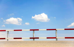 Traffic fence. Dangerous traffic fence beside street with blue sky for safety royalty free stock photo