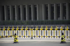 The traffic fence on the road. Black and yellow road fence in the town street Stock Images