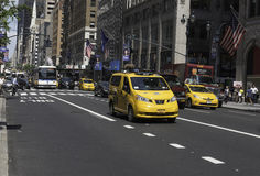 Traffic on Fifth Avenue. New York, NY USA--Aug 3, 2016 Traiffic is busy on Fifth Avenue as cabs, cars ans buses head South around lunchtime. Editorial Use Only Stock Photography