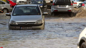 Traffic on a flooded street. Tulcea, Romania - September 13, 2013: European city flooded after a heavy rain stock footage