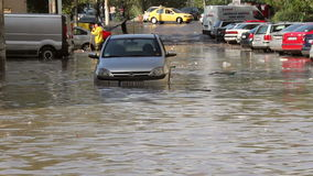 Traffic on a flooded street. Tulcea, Romania - September 13, 2013: European city flooded after a heavy rain stock video